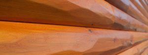 half log hewn cedar siding