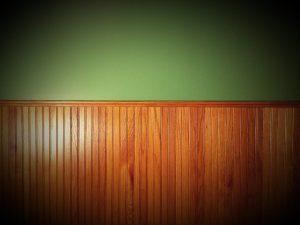 beautiful medium oak wainscoting with a green wall